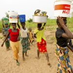 Girls and young women carrying water from Lake Tanganyika to their village of Nkonkwa. Photo Credit Ami Vitale, TNC