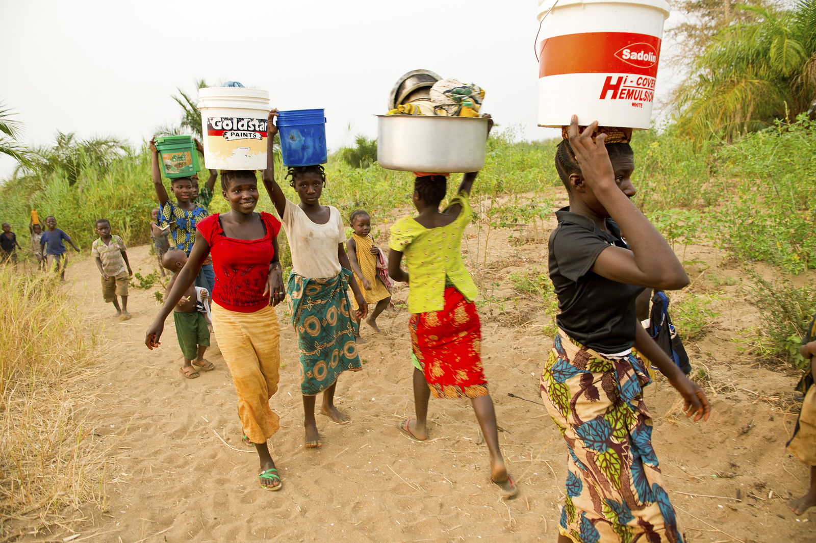 Girls and young women carrying water from Lake Tanganyika to their village of Nkonkwa, on Lake Tanganyika in Tanzania. The Nature Conservancy is launching a large-scale effort in the Greater Mahale Ecosystem, with Pathfinder International and the Frankfur